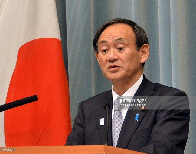 Japan top government spokesman Suga signals readiness to stem yen gains