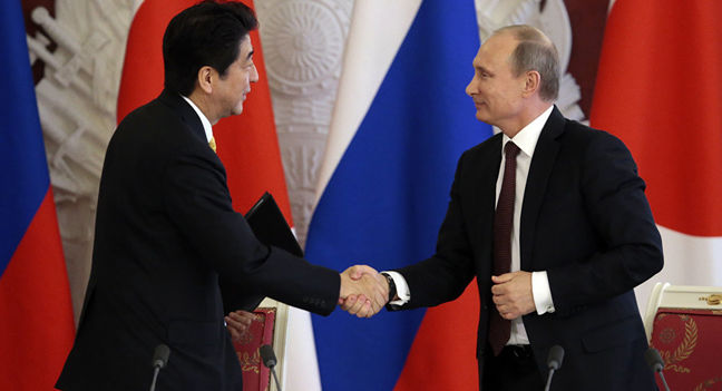Japan nudges wary firms to invest in Russia to help resolve islands dispute