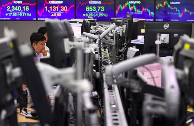 Traders Hold Back Before Fed Decides on Policy