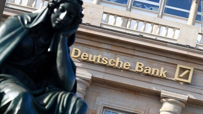 Wall St. falls; risk of Deutsche Bank fine hits banks