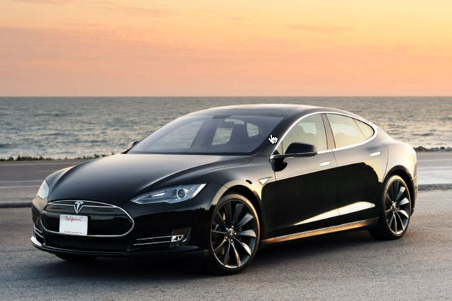 Tesla's Musk hands over first Model 3 electric cars to early buyers