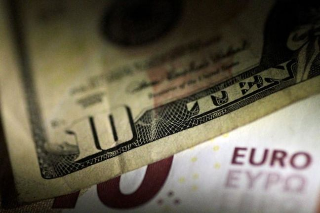 Dollar hits low note while euro shines; storms stoke worry in U.S.