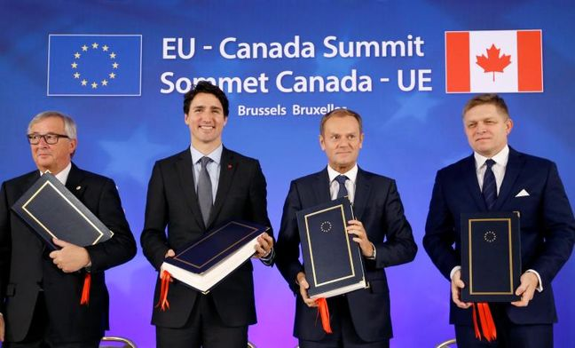 EU, Canada sign free trade deal but battle not over