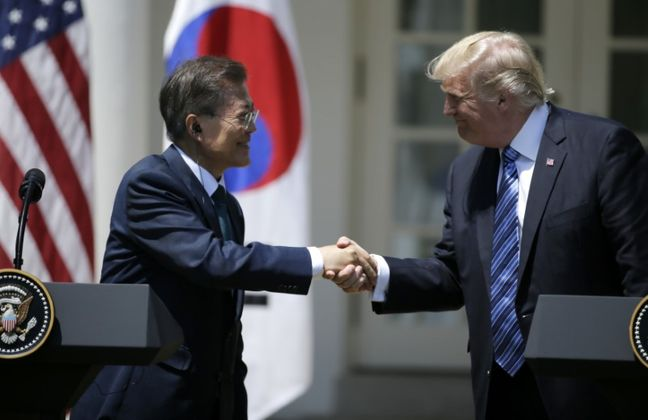 Trump calls for firm response to North Korea, targets Seoul on trade