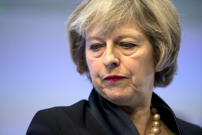May Sticks to Two-Year Brexit Deal Goal Amid Cabinet Doubts
