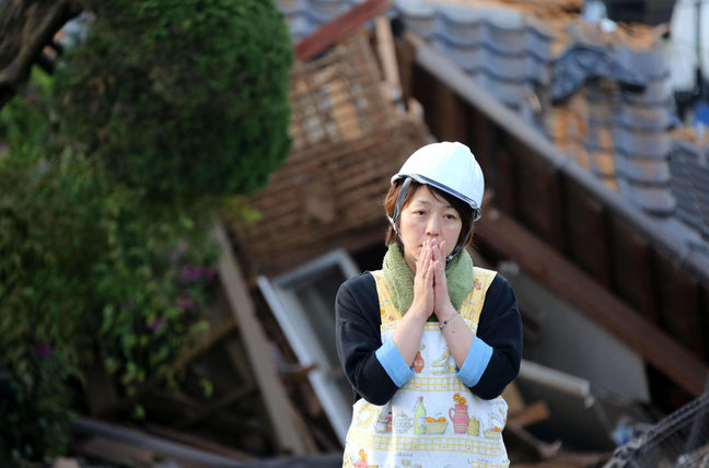 Japan struggles to deliver relief to victims of worst floods in decades