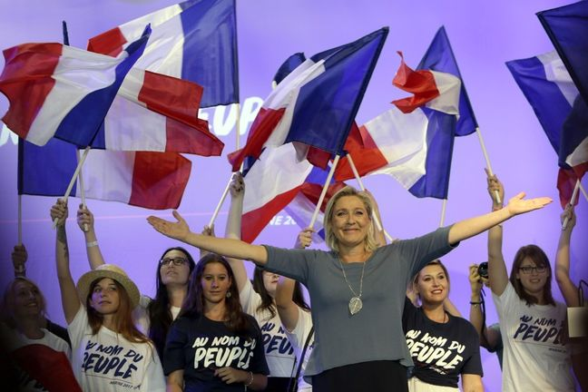 Europe's populist wave stalls as Macron storms into French runoff