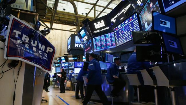 U.S. companies react cautiously to Trump victory