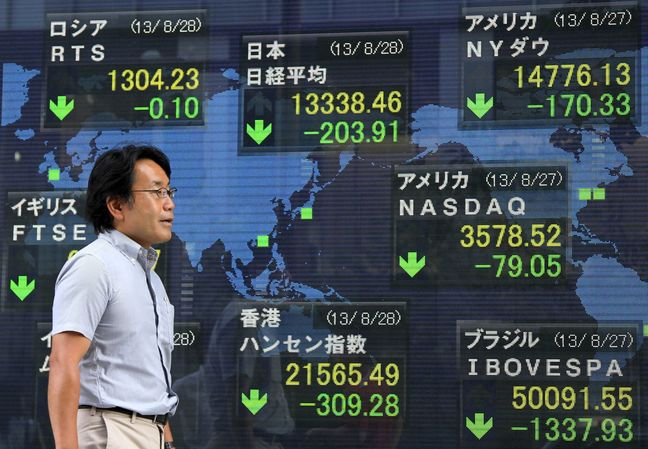 Asian stocks drop from one-year high, dollar rises on Fed rate comments