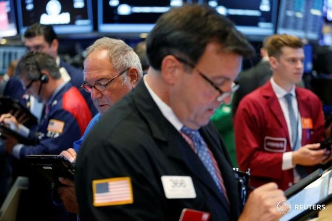 Global stocks fall in light trading as dollar rises on Fed hike bets