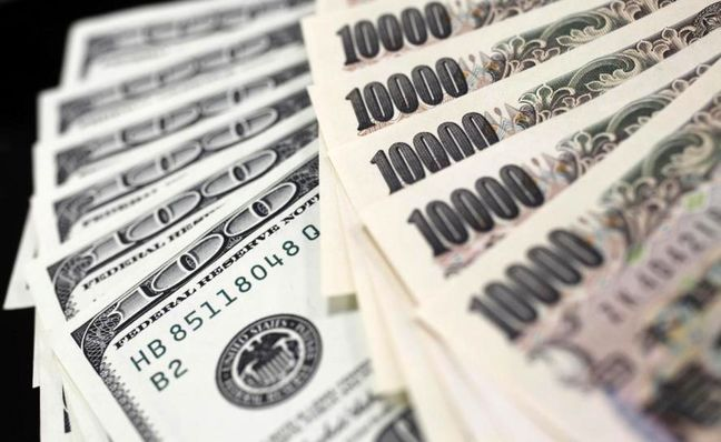 Dollar on defensive, hits one-month low vs yen