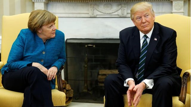 In first Trump-Merkel meeting, awkward body language and a quip