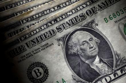 Dollar edges down as market awaits Fed minutes