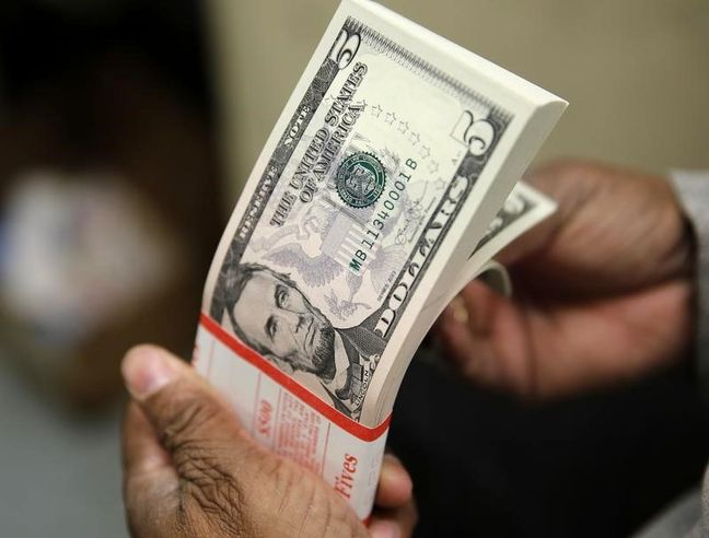 Dollar slips on lacklustre U.S. data, concerns over Trump trade policy